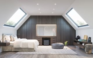 Loft conversion bedroom with natural light, two windows with strong light source. Neutral colours fill the room, as well as the wooden wall in the background adding warmth and homeliness.
